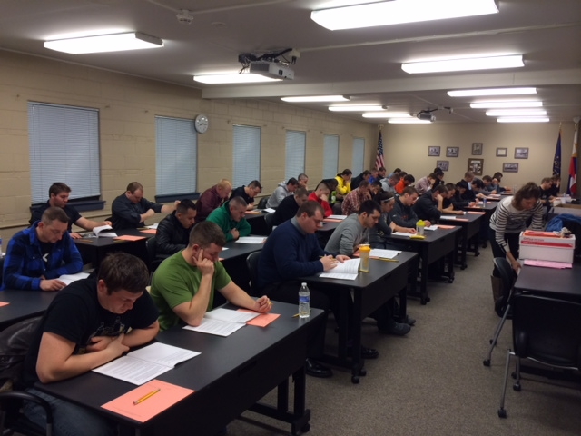 Group of Police Officer Candidates Taking the Written Testing